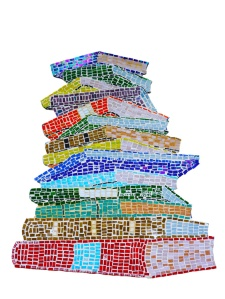 Mosaic of a pile of books created by members of the community in summer workshops, now installed by the entrance of the library